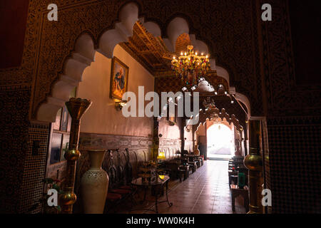 MARRAKESH, MOROCCO - JAN 2019: Inner hall of Riad in Marrakesh, Morocco. Rich riad interior Moroccan style arch stairs and mosaic