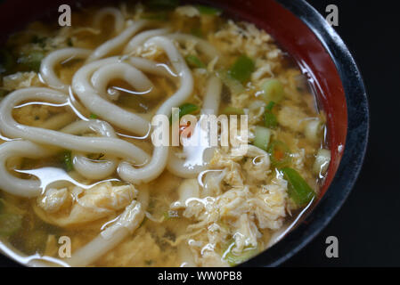 Close up of Japanese soup with traditional 'Udon' wheat flour noodle and egg - Stock Photo