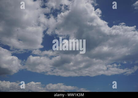 Clouds with blue sky in the background - Stock Photo