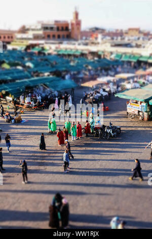 A tilt-shift effect picture of a group of dancers in Jamaa El Fna, Marrakesh - Stock Photo