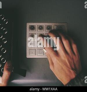 Cropped Image Of Woman Using Keypad On Atm - Stock Photo