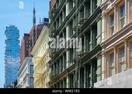 Soho New York, view of the Tribeca 'jenga building' and Cast Iron District buildings in Green Street in the Soho area of New York City, USA - Stock Photo