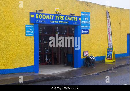 22 September 2019 Rooney's Tyre Centre Bundoran in County Donegal Ireland taken on a wet day. - Stock Photo