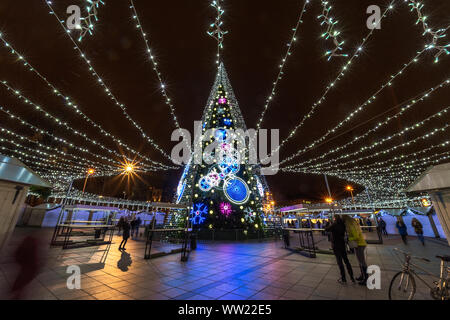 Night view of the ornate decorated and illuminated christmas tree  in Vilnius, Lithuania - Stock Photo