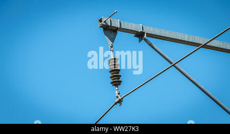 closeup of a catenary on a background of blue sky in France - Stock Photo