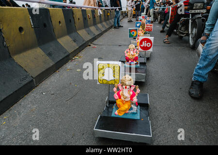 Hyderabad, India. 12th September, 2019. Hindu devotees carrying idols of Hindu god Lord Ganesha resembling a train with various technology company logos for immersion in Hussainsagar lake on the final day of Ganesh Chaturthi festival in Hyderabad, India. Credit:Sanjay Borra/Alamy News - Stock Photo