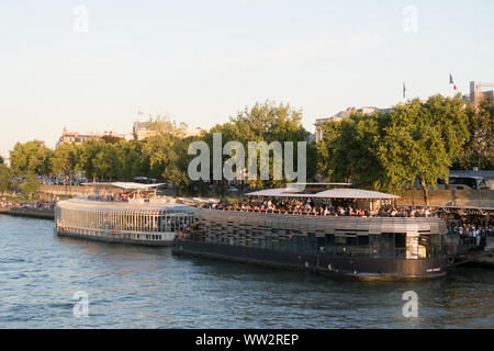 Paris, France - Aug 30, 2019: France, Paris, area listed as World Heritage by UNESCO, the New Berges at Quai d'Orsay with bar barges Flow and Rosa Bon - Stock Photo