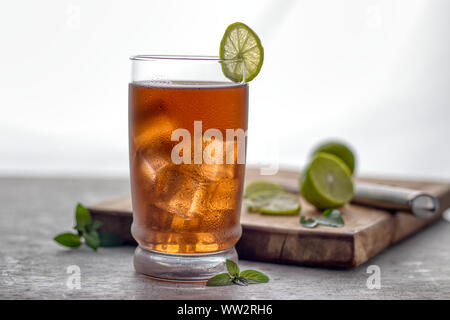 Delicious freshly made home cold ice tea, over a white background