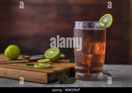 Delicious freshly made home cold ice tea, over a wood background