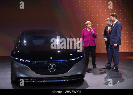 Frankfurt, Germany. 12th Sep, 2019. German Chancellor Angela Merkel (L) talks with Ola Kaellenius (R), CEO of Daimler, at the International Motor Show (IAA) 2019 in Frankfurt, Germany, Sept. 12, 2019. Germany's International Motor Show (IAA) 2019 opened officially on Thursday in Frankfurt, with a discussion of the future of mobility from industry representatives and government leaders. Credit: Lu Yang/Xinhua/Alamy Live News - Stock Photo