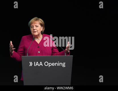 Frankfurt, Germany. 12th Sep, 2019. German Chancellor Angela Merkel addresses the opening ceremony of the International Motor Show (IAA) 2019 in Frankfurt, Germany, Sept. 12, 2019. Germany's International Motor Show (IAA) 2019 opened officially on Thursday in Frankfurt, with a discussion of the future of mobility from industry representatives and government leaders. Credit: Lu Yang/Xinhua/Alamy Live News - Stock Photo