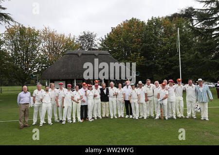 Goodwood, West Sussex, UK. 12th September 2019. The Goodwood Revival cricket matchs teams pose for a photo with the Duke of Richmond & Gordon. The teams include many famous drivers such as Derek Bell, Brendon Hartley, Stuart Graham and are called the Duke of Richmond & Gordon's XI and the Earl of March & Kinrara's XI at the Goodwood Revival in Goodwood, West Sussex, UK. © Malcolm Greig/Alamy Live News - Stock Photo