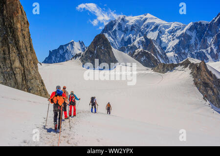 Group of climbers with the Mont Blanc massif in the background - Stock Photo