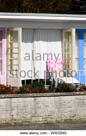 Open beach house with camping chair outside at Brunswick Terrace in Weymouth, Dorset, England