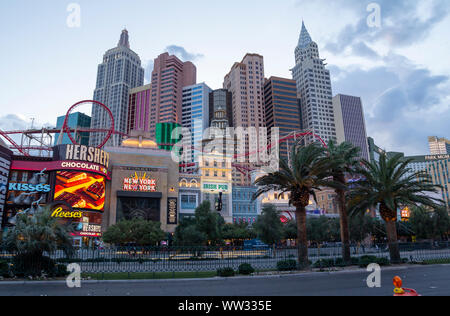 New York New York hotel and casino in Las Vegas Strip at sunset, with famous replica buildings - Stock Photo