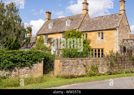 Cotswold stone houses in the village of Wood Stanway, Gloucestershire UK - Stock Photo