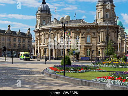 Ambulance waiting at traffic lights in the centre of Hull, East Yorkshire, England UK - Stock Photo