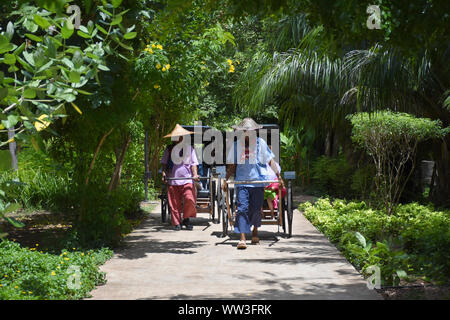 Kanchanaburi, Thailand, 09.09.2019: Locals are transporting tourists/guest in traditional Rickshaws in 'Mallika City R.E. 124', the heritage, retro-ci - Stock Photo