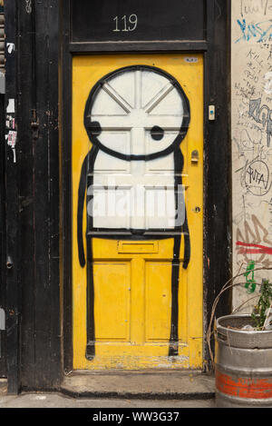 Stickman graffiti art painted on door in Shoreditch, East End, London, England, UK - Stock Photo