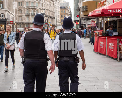 Two policemen on patrol in the West End, London, UK - Stock Photo