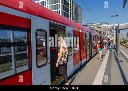 Passengers entering a Munich S-Bahn train at a platform in Munich, Bavaria, Germany. - Stock Photo