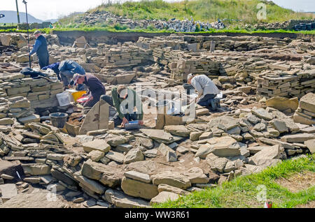 Excavation conducted  at Ness of Brodgar Archaeological Site Mainland Orkney Scotland - Stock Photo