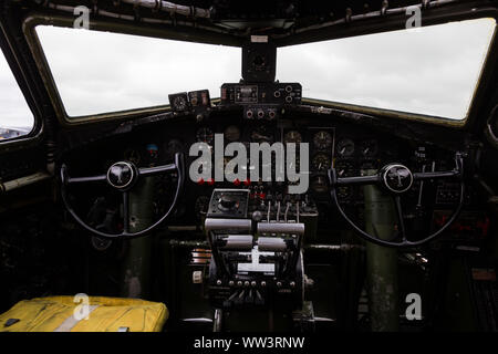 The cockpit of 'Texas Raiders,' an authentically restored WWII B-17G Flying Fortress Bomber sitting on static display at the Fort Wayne Airshow. - Stock Photo