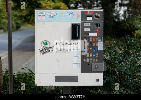 Cigarette vendor machine in the street on the central square of the german village of Grafschaft - Stock Photo