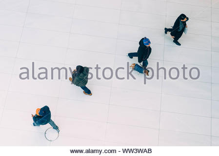 Two person walking going on right side together with dog and another two person walking going on left side - Stock Photo