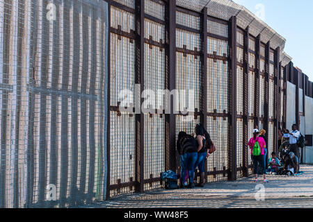 Friendship Park international border wall separating San Diego from Tijuana, where people gather to communicate with loved ones through the fence. - Stock Photo