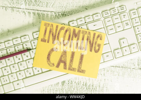 Text sign showing Incoming Call. Business photo showcasing Inbound Received Caller ID Telephone Voicemail Vidcall White keyboard office supplies empty - Stock Photo