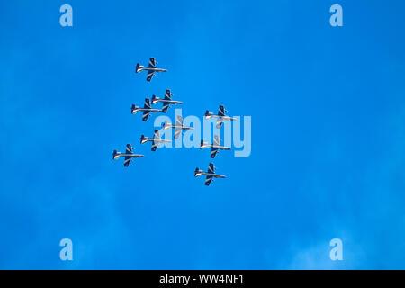 Italian aerobatic team Frecce Tricolori during a flight show in Lignano - Stock Photo