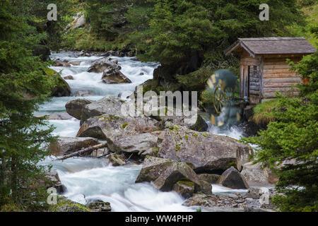 Wooden water mill. Krimmler Achen valley. Hohe Tauern National Park. Austrian Alps. - Stock Photo