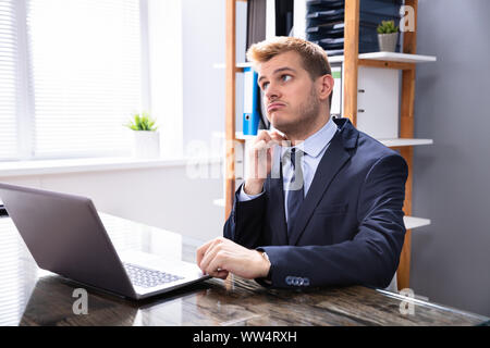 Mature Businessman Feeling Uncomfortable In Hot Office - Stock Photo