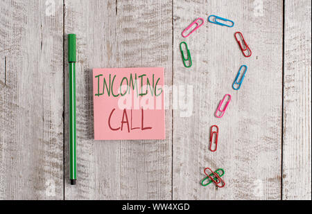 Word writing text Incoming Call. Business photo showcasing Inbound Received Caller ID Telephone Voicemail Vidcall Pastel colour note paper placed next - Stock Photo