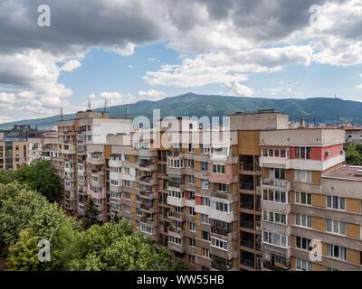 Communist era apartment blocks in front of Vitosha mountain, Sofia, Bulgaria - Stock Photo