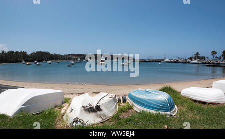 A panoramic view of fishing trawlers and smaller recreational boats moored in Ulladulla harbour on the south coast of New South Wales, Australia - Stock Photo