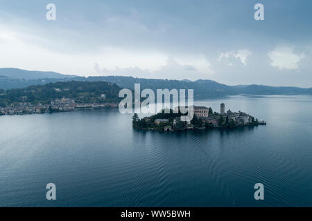 San Giulio island on Lake Orta (Piedmont, Italy) at evening. Aerial view. Italian landscape. - Stock Photo