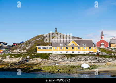 The Old Hospital (Det Gamle Sygehus) and Hans Egede statue on the hilltop beside the cathedral. Colonial Harbour, Nuuk (Godthab) Sermersooq Greenland - Stock Photo