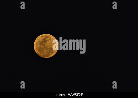 Full moon in a black sky - Stock Photo