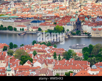 An aerial view of Prague with it's red rooftops on a sunny day in the Czech Republic. - Stock Photo