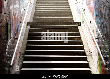 Photography of steps from a tiled tunnel,