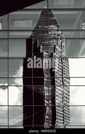 The abstract photography of the reflection of the Messeturm in Frankfurt in a glass front, - Stock Photo