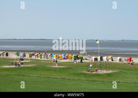 Camping site on the beach, in the background Wilhelmshaven, North Sea resort Dangast, Varel-Dangast, Lower Saxony, Germany, Europe - Stock Photo