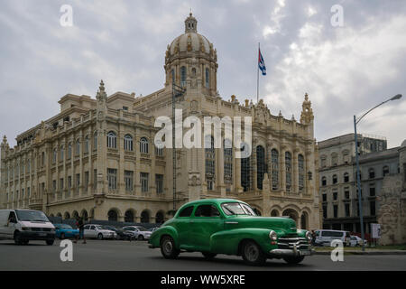 Revolution museum with vintage car in the old town of Havana, Cuba - Stock Photo