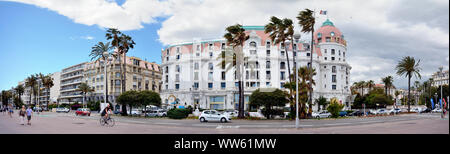A panoramic view of the Promenade des Anglais in Nice with the hotel Negresco. - Stock Photo