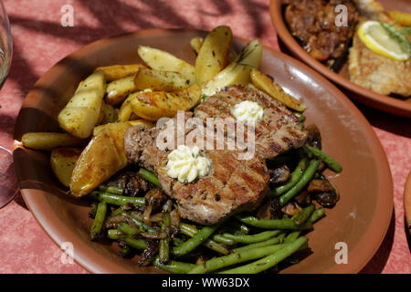 Steak with beans and potatoes, Castle Hartenfels in Torgau, Saxony, Germany - Stock Photo