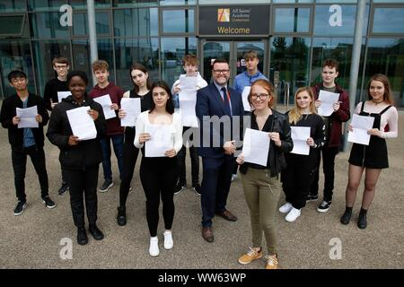 Dermot McNiffe, principal, with some of his successful pupils at GCSE results day at All Saints Academy, Cheltenham. 22/08/2019 Picture by Andrew Higg - Stock Photo