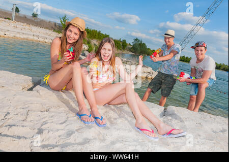 Group of teens at the riverside - Stock Photo