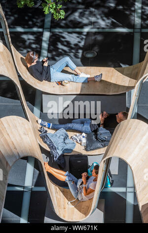 Broadgate, London, UK. 13th Sep 2019. Please be Seated by Paul Cocksedge. in Finsbury Avenue Square. Built from recycled scaffolding planks, repurposed using the innovative technology of Essex-based flooring company White & White, the whole structure can be broken down and transformed into something completely different after the festival, so nothing will be wasted - London Design Festival returns to the capital for its 17th year. Credit: Guy Bell/Alamy Live News - Stock Photo